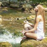 girl_meditating_river