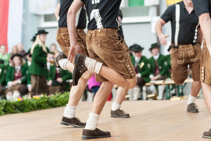 Young men doing an austrian traditional folk dance